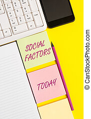 Conceptual hand writing showing Social Factors. Concept meaning Things that influences lifestyle Cultural Differences Empty papers with copy space on yellow background table