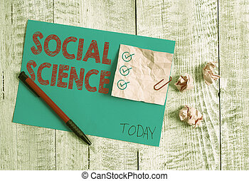 Conceptual hand writing showing Social Science. Concept meaning scientific study of huanalysis society and social relationships Wrinkle paper and cardboard placed above wooden background