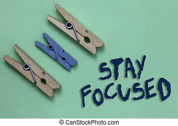 Conceptual hand writing showing Stay Focused. Business photo showcasing Be attentive Concentrate Prioritize the task Avoid distractions Three brown blue vintage clear background Holding things.