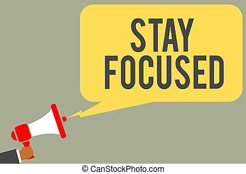 Conceptual hand writing showing Stay Focused. Business photo text Be attentive Concentrate Prioritize the task Avoid distractions Man holding megaphone loudspeaker speech bubble message speaking.