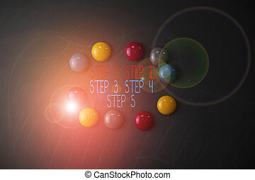 Conceptual hand writing showing Step 1, 2, 3, 4 and 5. Business photo showcasing Steps levels of a process work flow Round Flat shape stones with same sizes stick black board.