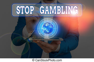 Conceptual hand writing showing Stop Gambling. Business photo text stop the urge to gamble continuously despite harmful costs Elements of this image furnished by NASA.
