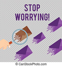 Conceptual hand writing showing Stop Worrying. Concept meaning stop thinking about something bad that happened in the past Magnifying Glass on Color Envelope and others has Same Shade