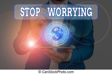 Conceptual hand writing showing Stop Worrying. Concept meaning stop thinking about something bad that happened in the past Elements of this image furnished by NASA