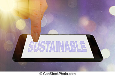 Conceptual hand writing showing Sustainable. Concept meaning the ability to be sustained, supported, upheld, or confirmed Modern gadgets white screen under colorful bokeh background
