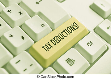 Conceptual hand writing showing Tax Deductions. Business photo showcasing reduction income that is able to be taxed of expenses White pc keyboard with note paper above the white background.