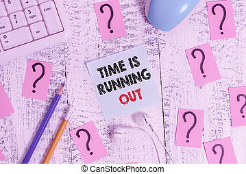 Conceptual hand writing showing Time Is Running Out. Business photo showcasing Deadline is approaching Urgency things cannot wait Writing tools and scribbled paper on top of the wooden table.