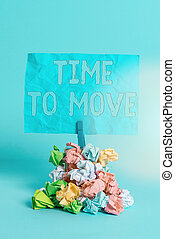 Conceptual hand writing showing Time To Move. Business photo text change in the same way or to reflect on what is current Reminder pile colored crumpled paper clothespin wooden space.
