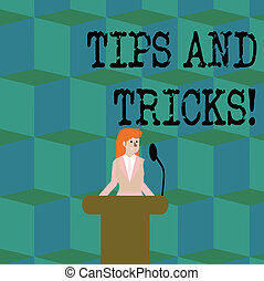 Conceptual hand writing showing Tips And Tricks. Business photo showcasing means piece advice maybe suggestion how improve Businesswoman Behind Podium Rostrum Speaking on Microphone.