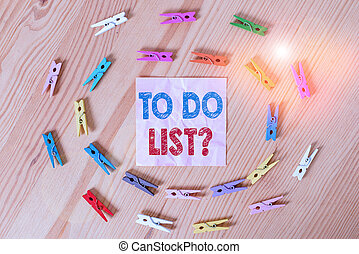 Conceptual hand writing showing To Do List Question. Business photo text Series of task to be done organized in priority order Colored crumpled papers wooden floor background clothespin.