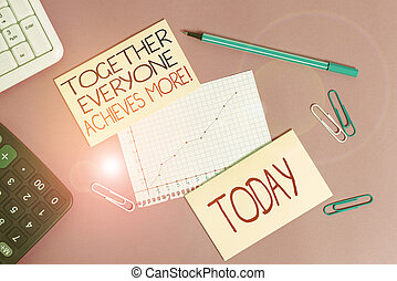 Conceptual hand writing showing Together Everyone Achieves More. Business photo text Members create synergy with strong sense mutual commitment Writing equipments and computer stuff placed on plain table.