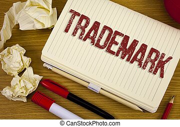 Conceptual hand writing showing Trademark. Business photo showcasing Legally registered Copyright Intellectual Property Protection written on Notebook Book on the wooden background Pen Pencil.