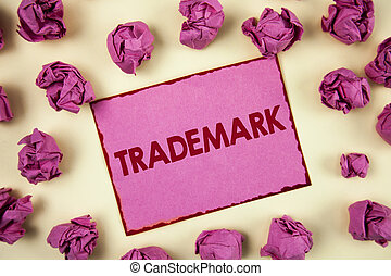 Conceptual hand writing showing Trademark. Business photo showcasing Legally registered Copyright Intellectual Property Protection written on Sticky Note Paper on plain background Paper Balls.