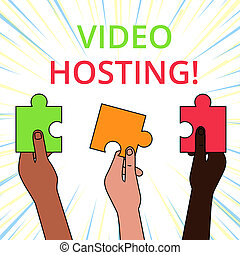 Conceptual hand writing showing Video Hosting. Business photo showcasing Enables users to upload and play back video content on the net Three Colored Jigsaw Puzzle Pieces in Different People Hands.