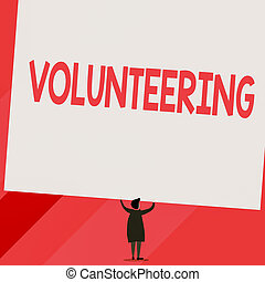 Conceptual hand writing showing Volunteering. Business photo...