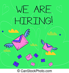 Conceptual hand writing showing We Are Hiring. Business photo showcasing recently you employ someone or pay someone to do particular job Colorful Airmail Letter Envelopes and Two of Them with Wings.
