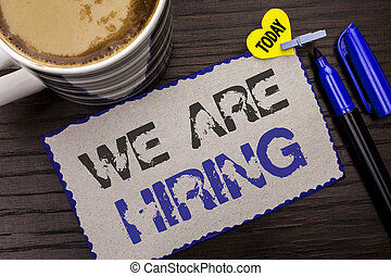 Conceptual hand writing showing We Are Hiring. Business photo showcasing Talent Hunting Job Position Wanted Workforce HR Recruitment written on Sticky Note wooden background Today Coffee Marker.