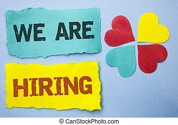 Conceptual hand writing showing We Are Hiring. Business photo showcasing Talent Hunting Job Position Wanted Workforce HR Recruitment written on Tear Papers on the Sky Blue background Hearts.