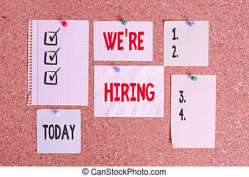 Conceptual hand writing showing We are Hiring. Business photo text process of reviewing applications and finding candidates Corkboard size paper thumbtack sheet billboard notice board.