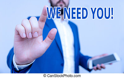 Conceptual hand writing showing We Need You. Business photo showcasing asking someone to work together for certain job or target Businessman pointing with pen in empty copy space.