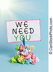 Conceptual hand writing showing We Need You. Business photo showcasing asking someone to work together for certain job or target Reminder pile colored crumpled paper clothespin wooden space.