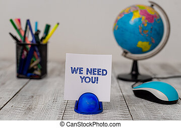 Conceptual hand writing showing We Need You. Business photo showcasing asking someone to work together for certain job or target Stationary and computer mouse with globe on the wooden desk.