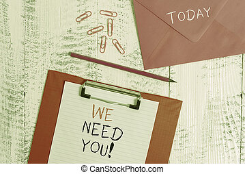 Conceptual hand writing showing We Need You. Business photo showcasing asking someone to work together for certain job or target Colored clipboard paper sheet pencil clips wooden background.
