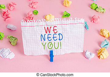 Conceptual hand writing showing We Need You. Business photo showcasing asking someone to work together for certain job or target Colored crumpled papers empty reminder pink floor clothespin.