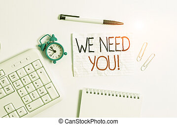 Conceptual hand writing showing We Need You. Business photo showcasing asking someone to work together for certain job or target Copy space on note paper with clock and pencil on the table.