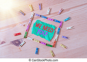 Conceptual hand writing showing We Need You. Business photo showcasing asking someone to work together for certain job or target Colored crumpled papers wooden floor background clothespin.