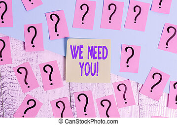 Conceptual hand writing showing We Need You. Business photo text asking someone to work together for certain job or target Crumbling papers with thick cardboard on the wooden table.