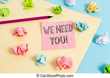 Conceptual hand writing showing We Need You. Business photo text asking someone to work together for certain job or target Colored crumpled papers empty reminder blue yellow clothespin.