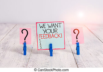 Conceptual hand writing showing We Want Your Feedback. Business photo showcasing criticism given someone say can be done for improvement Crumbling sheet with paper clips placed on the wooden table.
