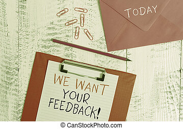 Conceptual hand writing showing We Want Your Feedback. Business photo showcasing criticism given someone say can be done for improvement Colored clipboard paper sheet pencil clips wooden background.