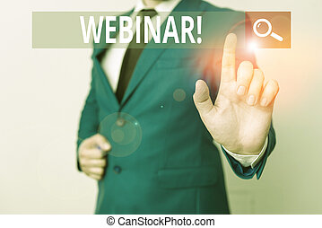 Conceptual hand writing showing Webinar. Business photo text seminar or other presentation types that takes place on Internet Businessman with pointing finger in front of him.