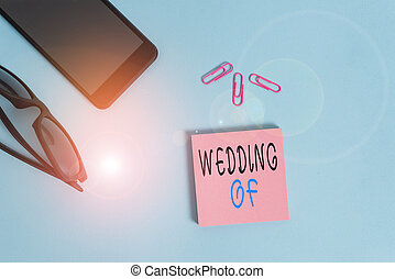 Conceptual hand writing showing Wedding Of. Concept meaning announcing that analysis and woanalysis now as married couple forever Eyeglasses colored sticky note smartphone pastel background