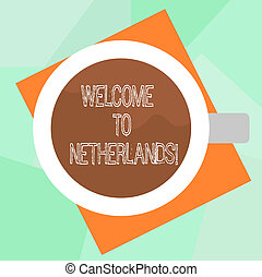 Conceptual hand writing showing Welcome To Netherlands. Business photo text Warm greeting to the visitors of Netherlands Top View of Drinking Cup Filled with Beverage on Color Paper.
