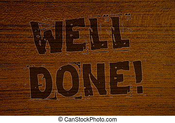 Conceptual hand writing showing Well Done Motivational Call. Business photos showcasing Good Job Great Results Positive EvaluationBold brown letters words ideas on wooden background concept messages.