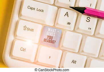 Conceptual hand writing showing What Gives You Meaning Question. Business photo showcasing your purpose or intentions in life White pc keyboard with note paper above the white background.
