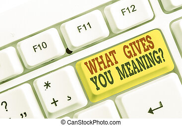 Conceptual hand writing showing What Gives You Meaning Question. Business photo text your purpose or intentions in life White pc keyboard with note paper above the white background.