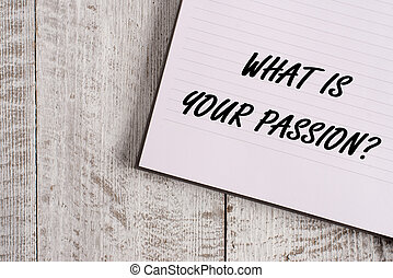 Conceptual hand writing showing What Is Your Passion Question. Business photo showcasing asking about his strong and barely controllable emotion Notebook stationary placed above classic wooden backdrop.