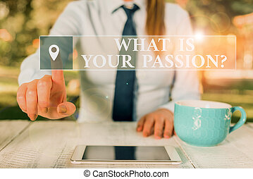 Conceptual hand writing showing What Is Your Passion Question. Business photo text asking about his strong and barely controllable emotion Female business person sitting and holding mobile phone.