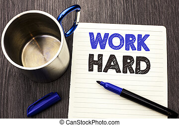 Conceptual hand writing showing Work Hard. Business photo showcasing Struggle Success Effort Ambition Motivation Achievement Action written on Notebook Paper wooden background Marker and Cup