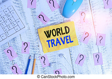 Conceptual hand writing showing World Travel. Business photo showcasing the movement of showing between distant geographical locations Writing tools and scribbled paper on top of the wooden table.