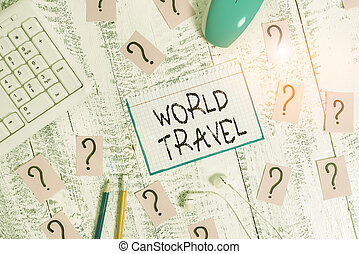 Conceptual hand writing showing World Travel. Business photo text the movement of showing between distant geographical locations Writing tools and scribbled paper on top of the wooden table.