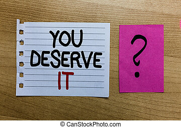 Conceptual hand writing showing You Deserve It. Business photo text Reward for something well done Deserve Recognition award white page on wooden desk with words violet with question mark.