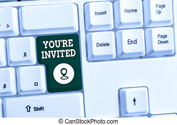 Conceptual hand writing showing You Re Invited. Business photo text Please join us in our celebration Welcome Be a guest White pc keyboard with note paper above the white background.