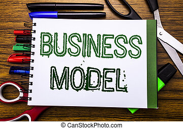 Conceptual hand writing text Business Model.  Concept for Solution Strategy Plan Written on notebook, wooden background with office equipment like pens scissors colourful marker