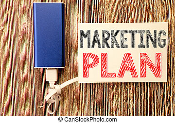 Conceptual hand writing text caption inspiration showing Marketing Plan. Business concept for Planning Successful Strategy written on sticky note old wood wooden background with power bank