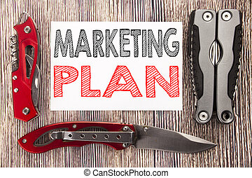Conceptual hand writing text caption inspiration showing Marketing Plan. Business concept for Planning Successful Strategy Written on sticky note wooden background with pocket knife